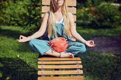 Cropped photo head of beautiful meditating female outdoors