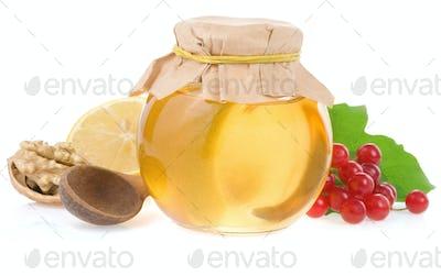 honey and fruit isolated on white