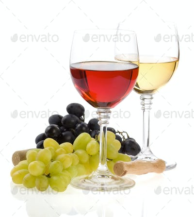 wine in glass and grape fruit isolated on white