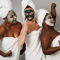Multigenerational women having fun wearing face beauty mask