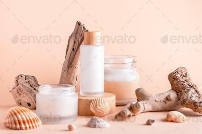 Scincare cosmetics, facial moisturizer, body scrub on podiums with seashells