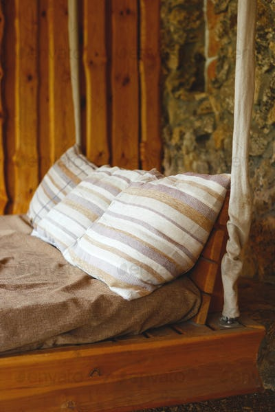 rest zone. rustic wooden hanging bed outdoors