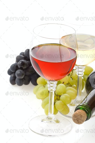 wine in glass and grape isolated on white