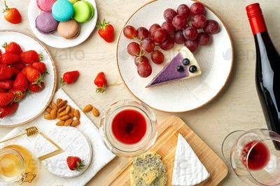 Beautiful composition with strawberry, grapes, cheese and blueberry cheesecake