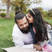 Indian father enjoy pic nic with daughter at city park
