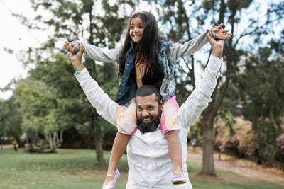 Indian father and child having playful time at city park - Family love concept