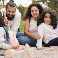 Happy indian family enjoy day outdoor with picnic while painting together