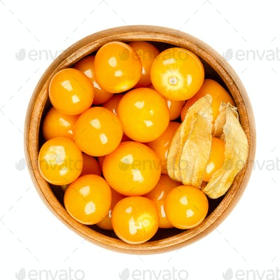 Cape gooseberries, fruits of Physalis peruviana, in a wooden bowl