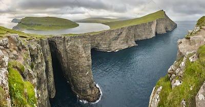 Dramatic atlantic rocky coastline cliffs landscape in Vagar. Faroe islands