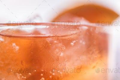 Orange cocktail close up. Studio shot
