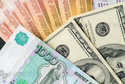 US Dollar and Russian Ruble banknotes close up