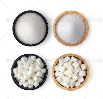 Sugar cube and sugar in a bowl isolated on white background