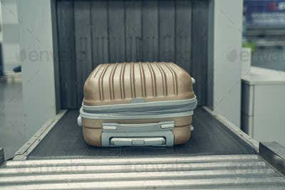 Close up of suitcase that being under control