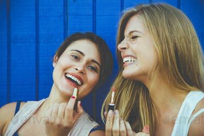 Friends having fun against blue background