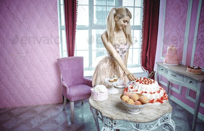 Blonde doll girl in a toy house