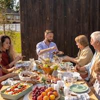 Big Family Eating Tasty Food