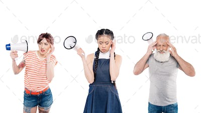portrait of multiethnic people with megaphones in hands isolated on white