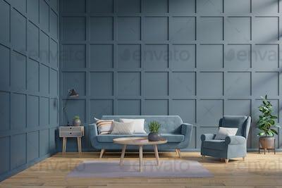 Blue sofa and armchair against dark blue wall.