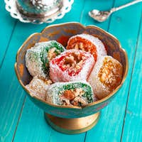 Traditional turkish coffee and turkish delight on wooden background