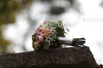 Wedding bouquet on the stone block