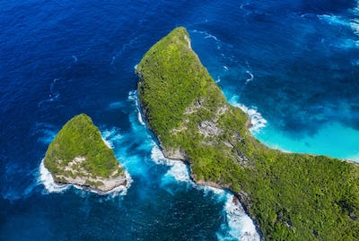 Aerial view at sea and rocks. Turquoise water background from top view. Summer seascape from air.