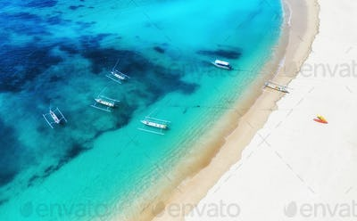 Boats on the water surface from top view. Turquoise water background from top view.