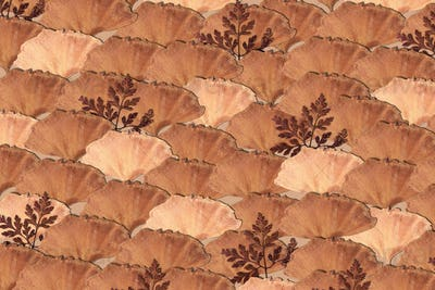 Dried leaf patterned background in beige