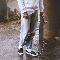 Streetwear fashion man with a skateboard