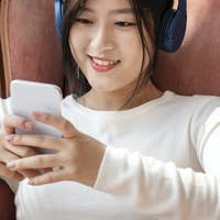 Asian woman watching a video clip from the phone
