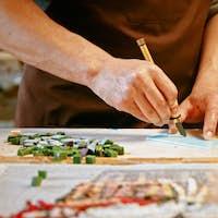 Male hands cutting a piece of glass in creative studio