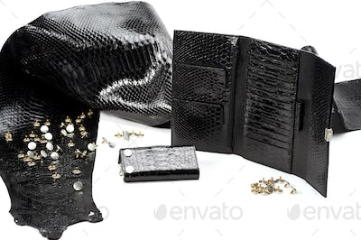 Black smooth pieces of leather look like reptile skin