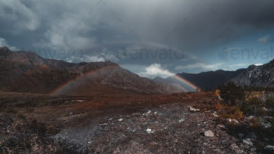 Double rainbow in the mountains