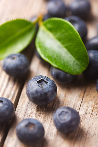 Organic blueberries close up on wooden background