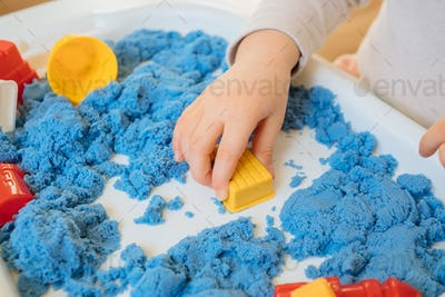 Child Playing With Kinetic Sand