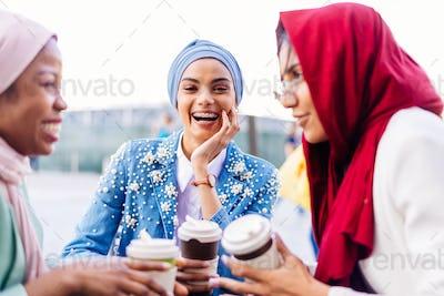 Beautiful muslim girl wearing hijab bonding outdoors