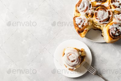 Cinnamon buns or rolls close up on white background