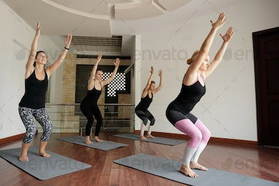 Young Women Doing Chair Pose