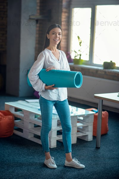 Pleasant young woman being ready to train