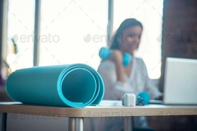 Selective focus of a blue yoga mat