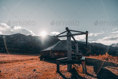 Fall mountain scenery with a hut