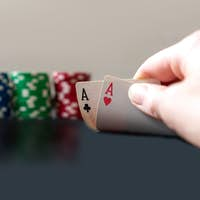 Person showing her deck at the poker