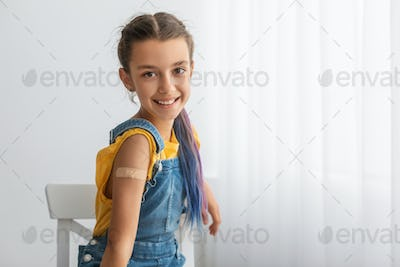 Happy Vaccinated Teen Girl Showing Shoulder After Inoculation