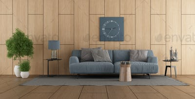 Wooden paneling in a modern living room with sofa