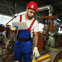African american male manager in electric cable warehouse holding digital tablet