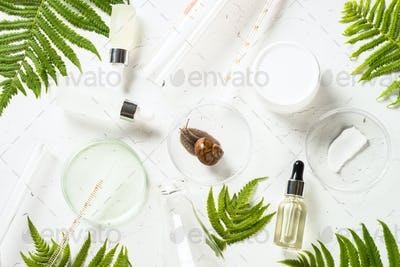 Snail mucin products at white background. Natural cosmetic