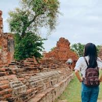 Traveler Asian woman spending holiday trip at Ayutthaya, Thailand.