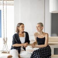 Lesbian couple talk and hug at home