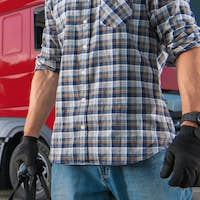 Pro CDL Semi Truck Driver Preparing For Another Trip