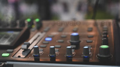 Audio sound mixer console with night time.