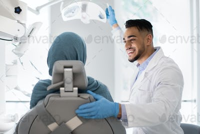 Young Arab Dentist Doctor Having Check Up With Islamic Female Patient
